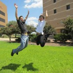 Two students jumping